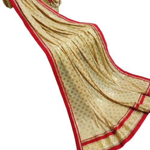 Beige Faux Crepe Golden Saree red Velvet Border